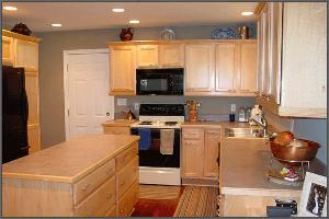 Kitchen Island and White Cupboards in Kitchen Remodeling